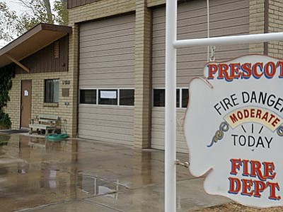 Matt Hinshaw/The Daily Courier, file<br> Handwritten signs hang in the window and on the door of Prescott Fire Department's Station 3, located at the Prescott Airport, notifying the public that the station was closed for a day in early October – a temporary brown-out, cost-cutting measure. Budget cuts that the City of Prescott, approved by the City Council on Tuesday, Nov. 10, will see impacts across all departments including fire and police.