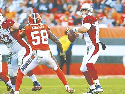 Jeff Haynes/AP Images for Panini, file<br> Arizona Cardinals quarterback Carson Palmer looks to pass against the Cleveland Browns during their game Sunday, Nov. 1, in Cleveland. Arizona won 34-20.