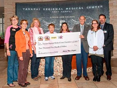 Courtesy photo<br> Participating in the check presentation to The BreastCare Center at YRMC are (left to right): Mary Ann Suttles, Prescott Frontier Days; Nancy Ledoyen, YRMC; Mella Dee Wagner, Prescott Frontier Days; Irene Winter, Prescott Frontier Days; Brenda Steelman, Prescott Frontier Days; Seymour Dicker, YRMC Foundation; Julie Bender, YRMC; and John Amos, YRMC.