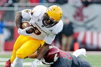 AP Photo/Young Kwak<br /><br /><!-- 1upcrlf2 -->Arizona State running back Kalen Ballage (9) is tripped by Washington State safety Isaac Dotson (31) during the second half of an NCAA college football game, Saturday, Nov. 7,  in Pullman, Wash. Washington State won 38-24.
