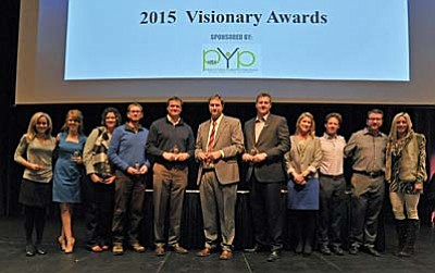 Matt Hinshaw/The Daily Courier, file<br> Recipients of the Prescott Area Young Professionals 2015 Visionary Award gather for a photo with the Core Leadership Group Thursday, Jan. 29, during the Prescott Chamber of Commerce Annual Meeting at the Yavapai College Performance Hall in Prescott.