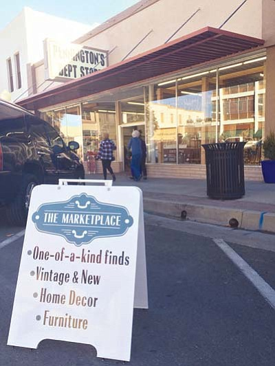 A sign sits out front of what used to be Pennington's Antiques and Décor with the store's new name, The Marketplace. (Max Efrein/The Daily Courier)<br /><br /><!-- 1upcrlf2 -->