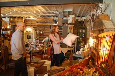Shoppers Timothy and Brittany Winslow look at various items in 5ive, A Vintage Market. (Max Efrein/The Daily Courier)