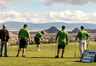 Participants in the Ninth Annual Windermere Foundation Golf Tournament at Prescott Lakes Golf Club on Oct. 19 enjoy a fine day of golfing to raise money for charities. (Courtesy)