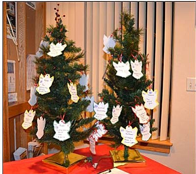 Courtesy photo<br>Two angel trees offer Emmanuel worshipers the opportunity to select a tag and make sure a child has Christmas gifts this year.