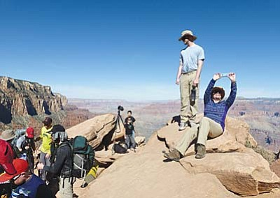 The Associated Press/Anna Johnson, File<br> In this March 16 photo, hikers stop and take photos along the Grand Canyon National Park's South Kaibab trail.