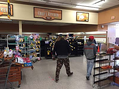 Max Efrein/The Daily Courier<br>Customers browse the last few remaining items sectioned off near the entrance of the store. Everything was going for 80 to 90 percent off.