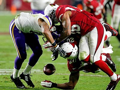 Rick Scuteri/The AP<br> Cardinals strong safety Deone Bucannon (20) forces Minnesota Vikings wide receiver Jarius Wright (17) to fumble as free safety Rashad Johnson (26) during their game Thursday, Dec. 10, in Glendale. Bucannon recovered the fumble for the Cardinals.