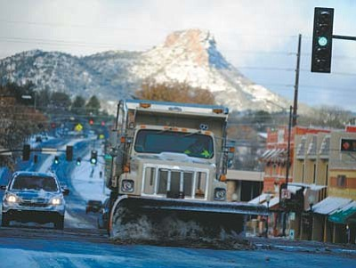 A city of Prescott snowplow hits the intersection of Montezuma and Gurley Streets after the Prescott area received its second snowfall of the season. The National Weather Service is predicting sunny weather today with a high near 33 degrees. (Les Stukenberg/The Daily Courier)