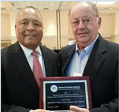 Courtesy photo<br> Matforce has earned the prestigious National Exemplary Award. Dr. Leon Cattolico, right, of the Matforce Board of Directors, displays the award with General Arthur Dean, chairman and CEO of CADCA, the Community Anti-Drug Coalitions of America.