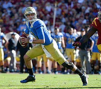 AP Photo/Jae C. Hong, File<br /><br /><!-- 1upcrlf2 -->In this Nov. 28 file photo, UCLA quarterback Josh Rosen breaks away from a Southern California defender during the first half of an NCAA college football game, in Los Angeles. Rosen was named to the Pac-12 All-Conference team Thursday.