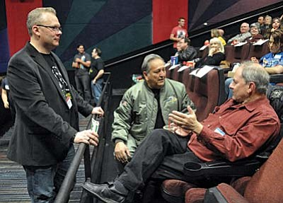 Matt Hinshaw/The Daily Courier<br>Alan Dean Foster, right, author of the original Star Wars novel and The Force Awakens novel to be released in January, chats with James Hait, left, owner of Victory Wealth Services and Frank Abril, former Disney set painter.