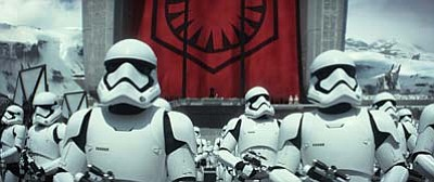 "Stormtroopers in a scene from the new film, ""Star Wars: The Force Awakens."" (Film Frame/Lucasfilm via AP)"