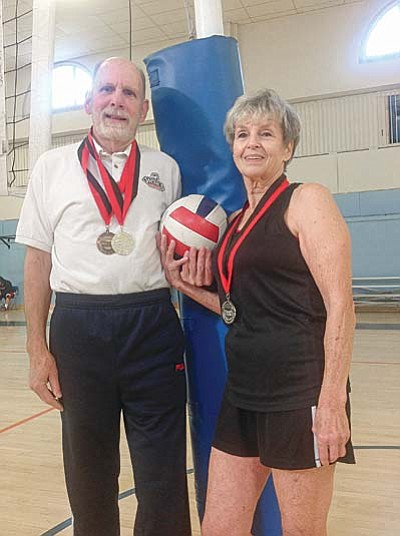 In October, senior volleyball players George Hedge, 76, and Ginger Rhodes, 77, of Prescott competed on separate teams at the 2015 Huntsman Senior World Games in St. George, Utah, where they were awarded medals for their efforts. Here they are shown at Grace Sparkes Activity Center in Prescott, where they practice and play.