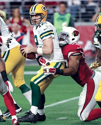 Green Bay Packers quarterback Aaron Rodgers is sacked by Arizona Cardinals outside linebacker Alex Okafor during the second half of the game, Sunday, Dec. 27, in Glendale. (AP Photo/Ross D. Franklin)