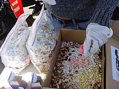 Courtesy MATFORCE<br>A Dump the Drugs project; MATFORCE has conducted these prescription painkiller and medication drop-off events since 2008 and over the years has collected some 17,000 pounds of unused or expired medications