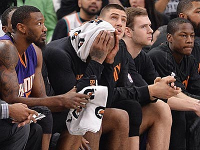 Darren Abate/The AP<br> Phoenix Suns players watch play from the bench during their game against the San Antonio Spurs, Wednesday, Dec. 30, in San Antonio.