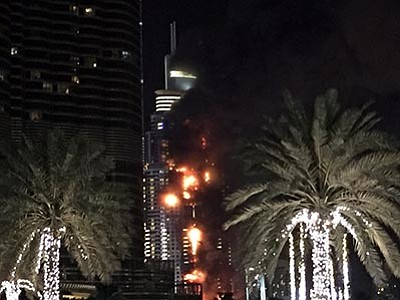 Jon Gambrell/The AP<br> A fire runs up some 20 stories of a building in Dubai, United Arab Emirates, Thursday, Dec. 31. The fire broke out Thursday in a residential building near Dubai's massive New Year's Eve fireworks display. It was not immediately clear what caused the fire near the Burj Khalifa, the world's tallest skyscraper at 828 meters (905 yards).