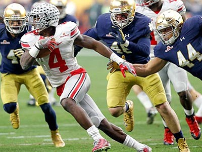 Rick Scuteri/The AP<br> Ohio State running back Jalin Marshall is pressured by Notre Dame defensive lineman Doug Randolph (44) during the Fiesta Bowl  game Friday, Jan. 1, in Glendale.