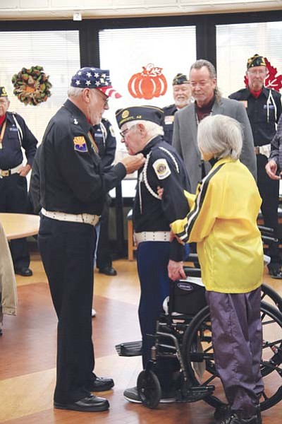 World War II U.S. Army Col. John Mortimer, 96, is presented his colonel wings in a ceremony at the VA's Community Living Center, where he is a resident. (Courtesy/VA)<br /><br /><!-- 1upcrlf2 -->
