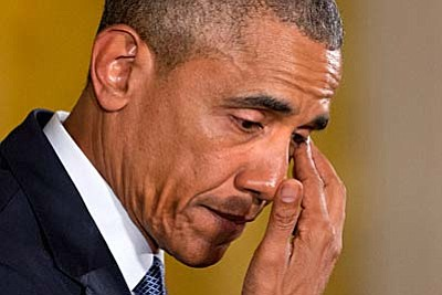 An emotional President Barack Obama pauses to wipe away tears as he recalled the 20 first-graders killed in 2012 at Sandy Hook Elementary School, while speaking in the East Room of the White House in Washington, Tuesday, Jan. 5, 2016, about steps his administration is taking to reduce gun violence. (AP Photo/Jacquelyn Martin)