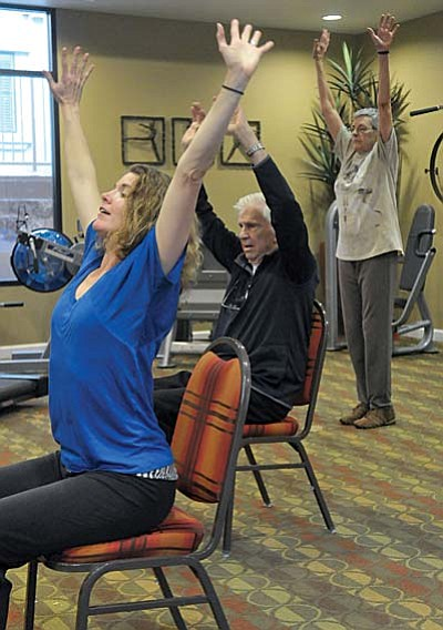 Matt Hinshaw/The Daily Courier<br>From left, Mary Heller a Breadth of BeMoved Instructor, works with Henry Ebbets, Janet Allen, and others during the Breadth of BeMoved senior dance and exercise program Tuesday afternoon at Alta Vista Senior Living in Prescott.
