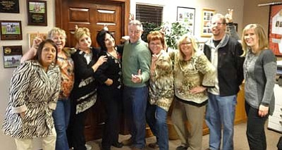 "The Prescott Valley Chamber Ambassadors are a lively and fun group of business people. They are the hospitality arm of the Chamber and enjoy meeting new members and assisting with ribbon cuttings and grand openings. The Ambassadors won first place for their entry in the Holiday Festival of Lights parade with their ""I want a Hippopotamus for Christmas"" themed float."