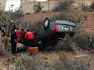 Scott Orr/Daily Courier<br> A minivan went of the road in Cliff Rose Monday morning and rolled down an embankment.