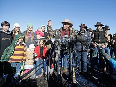Rick Bowmer/The AP, file<br> LaVoy Finicum, center, a rancher from Cane Beds, Arizona, speaks to reporters as his family looks on, left, during a news conference at Malheur National Wildlife Refuge Friday, Jan. 8, near Burns, Oregon. Ammon Bundy, the leader of a small, armed group occupying a national wildlife refuge, says the activists have no immediate plans to leave.