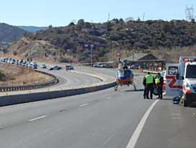 Tim Wiederaenders/The Daily Courier, file<br> The divider down the middle of Highway 69 is visible in this Courier file photo from Dec. 25, 2011, when rescue crews and a helicopter worked a single-vehicle crash. The divider prevented the car from going into oncoming traffic.