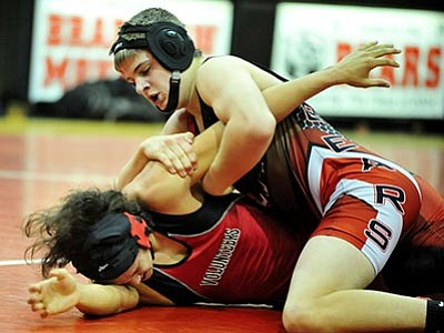 Les Stukenberg/The Daily Courier<br> Bradshaw Mountain's Jacob Kidd turns a Lee Williams High School wrestler in the Bears' final home match of the season Wednesday night.