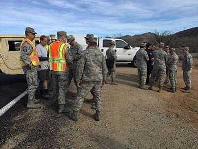 Courtesy photo<br> US Air Force personnel gather near the crash site Thursday.