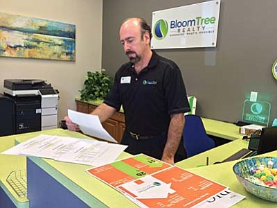 Max Efrein/The Daily Courier<br /><br /><!-- 1upcrlf2 -->Paul Aslanian, Designated Broker at Bloomtree Realty in Prescott, pores over sheets of statistics he gathered on how the greater Prescott area real estate market performed in 2015 compared to previous years.