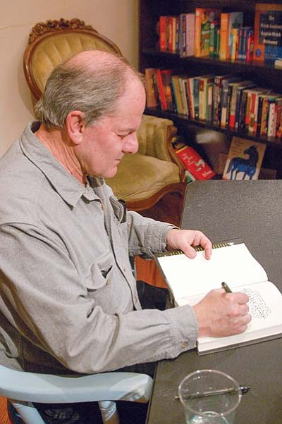 """Star Wars"" novelist Alan Dean Foster signs a book at Peregrine Book Company on Saturday, Jan. 23. (Jason Wheeler/The Daily Courier)"