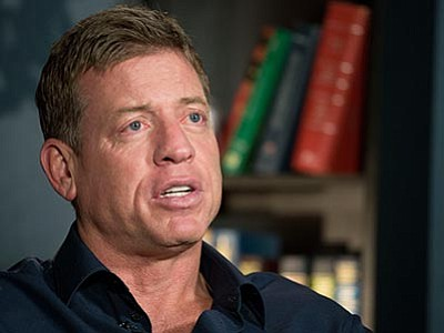 Mark Lennihan/The AP<br> Former Dallas Cowboys quarterback Troy Aikman talks Wednesday, Jan. 27, in New York about how, if Cam Newton has the type of Super Bowl debut Aikman did, the Carolina Panthers will be in good shape for the Super Bowl.