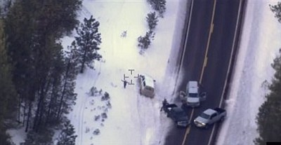 """This photo taken from an FBI video shows Robert """"LaVoy"""" Finicum before he was fatally shot by police Tuesday, Jan. 26, 2016 near Burns, Ore. A video released Thursday, Jan. 28, 2016 by the FBI of the shooting death of a spokesman for the armed occupiers of a wildlife refuge shows the man reaching into his jacket before he fell into the snow. The FBI said the man had a gun in his pocket. (FBI via AP)"""