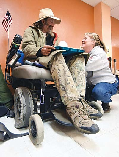 Matt Hinshaw/The Daily Courier<br /><br /><!-- 1upcrlf2 -->Veteran Outreach case manager Dawn Marie Hayden with Catholic Charities chats with homeless U.S. Navy veteran Nick about the problems with his wheelchair recently at the Salvation Army during their free breakfast for the homeless in downtown Prescott.