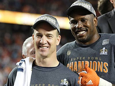 Gregory Payan/The AP<br> Denver Broncos' Von Miller, right, and QB Peyton Manning are seen post-game after beating the Carolina Panthers in Super Bowl 50 on Sunday, Feb. 7, in Santa Clara, California.