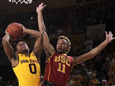 Ricardo Arduengo/Associated Press<br> Arizona State guard Tra Holder (0) goes to the basket against Southern California guard Jordan McLaughlin during the first half of an NCAA college basketball game in Tempe, Ariz., Friday, Feb. 12.