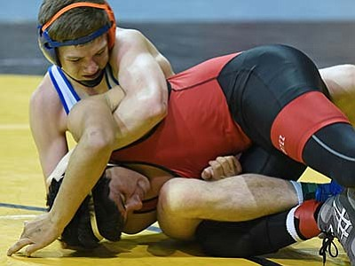 Matt Hinshaw/The Daily Courier<br> Chino Valley's Nic Dalcerro puts Cortez's Camilo Dela Torre-Hern into a hold Friday afternoon during the AIA Division III State Wrestling Tournament at the Prescott Valley Event Center.