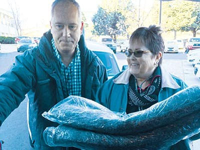 Nanci Hutson/The Daily Courier<br> VA Homeless Outreach Team Point-In-Time members Markham Breen, a social worker and the VA liaison with U.S. Vets Initiative, and Frazier Mayer, a medical support assistant, load up a van with blankets, sleeping bags and water to distribute to homeless they encounter during the Point-In-Time Count on Jan. 27.