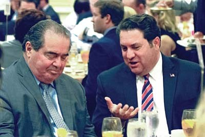 Supreme Court Justice Antonin Scalia, left, speaks with Arizona Attorney General Mark Brnovich last year in Phoenix. Scalia's death could change the outcome of some key Supreme Court cases. (Howard Fischer/Capitol Media Services, file)