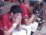 Courier/Jo. L. Keener Keith Collins, left, and Kris Vanzant sit dejected after losing to Cactus Thursday afternoon in Wells Fargo regional play at the Peoria Sports Complex.