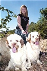 Courier/Nathaniel Kastelic Katie Waldock, honors student at Tri-City Prep High School, poses with her show dogs Monroe, left, and Sedona, both purebred clumber spaniels, Monday afternoon in the front yard of her Prescott home.