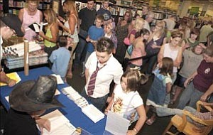 """Courier/Nathaniel Kastelic  Harry Potter fans stand in line Friday night to receive their reserved tickets, which guarantee them a copy of the new sixth edition, """"Harry Potter and the Half Blood Prince,"""" when they return at midnight in the Barnes and Noble Book Store at the Prescott Gateway mall."""