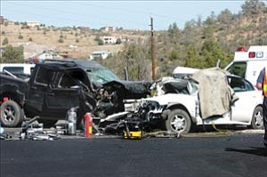 Courier/Les Stukenberg Two people died and one was airlifted to a Phoenix hospital in this two-vehicle collision just east of Walker Road on Highway 69 in Prescott Tuesday morning.