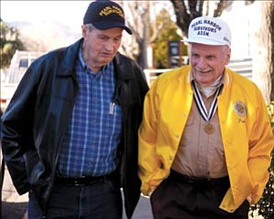 Courier/Les Stukenberg Bill Lyon, left, and Frank Murphy, both United States Navy Pearl Harbor survivors, talk as they walk along one of the sidewalks at the VA hospital in Prescott Tuesday morning.