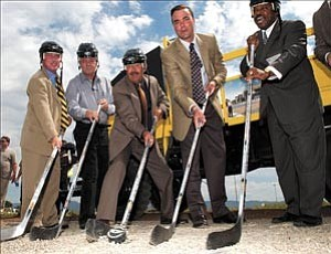 Facing off at the groundbreaking of the new Global multi-purpose arena, from left, Larry Tarkowski, town manager; Bill Fain of Fain signature group; Lew Rees, Prescott Valley Chamber; Brad Fain, Fain Signature Group, and Wayne H. Davis of Global marketing. Courier photo/Jo.L. Keener