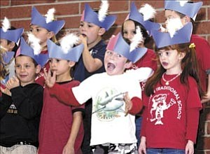 Courier/Les Stukenberg Some students have fun as the all-day kindergarten class from Washington Traditional School presents a patriotic program Tuesday afternoon.