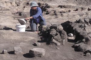 Courier file photo Archaeologist Judy Breen of Logan Simpson Design works at an archaeological site near Willow Lake in this March 2003 file photo. The dig uncovered several Native American residences and well-preserved artifacts, such as a metate, pictured in the foreground.